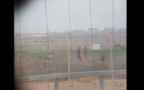 A screen capture from a video publicized on April 9, 2018 that appeared to show IDF soldiers celebrating after a sniper shoots and fells a Palestinian near the Gaza border fence. (Screen capture: YouTube)