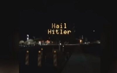 "A road sign in Pinal County, Arizona, that was hacked to read ""Hail Hitler,"" on April 27, 2018. (Screen capture: YouTube)"