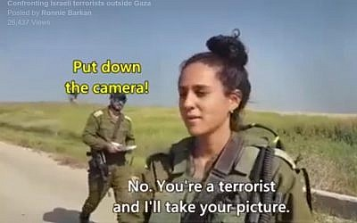 Screen capture from April 2018 video showing left-wing activists telling IDF soldiers on the border with the Gaza Strip that they are 'terrorists' who are 'massacring innocent civilians.' (Facebook)