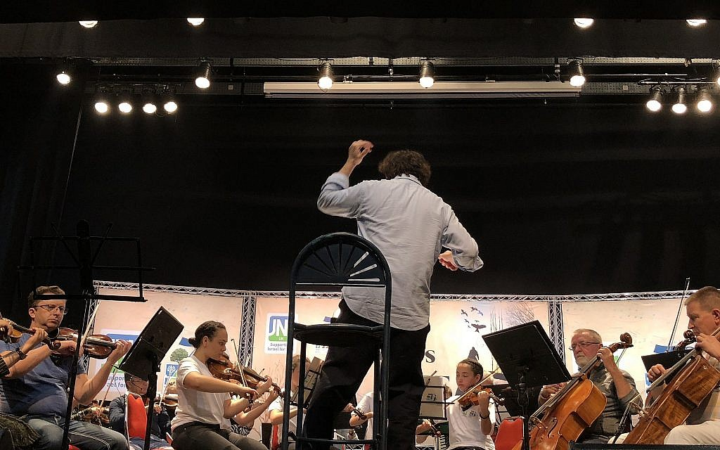 Italian conductor Francesco Lotoro rehearses his concert of reconstructed musical compositions created in the concentration camps, April 8, 2018 (Jessica Steinberg/Times of Israel)