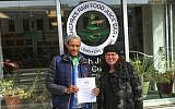 Maharat Ruth Friedman with the manager of Khepra's Raw Food Juice Bar, a vegan restaurant she and Rabbi Shmuel Herzfeld recently certified kosher. (Courtesy of Friedman/via JTA)