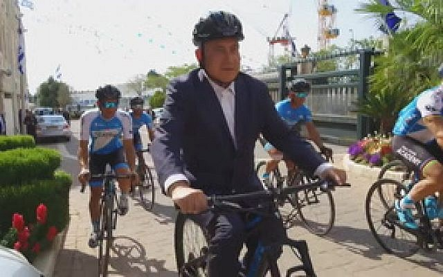 Prime Minister Benjamin Netanyahu wears a helmet while riding a bicycle in a video released on April 25, 2018, ahead of the Giro D'Italia cycle race to be held in Israel in May. (Screen capture: Twitter video)