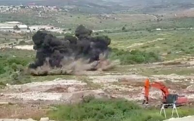 A Defense Ministry unit detonates mines near the Karnei Shomron settlement in the northern West Bank. (Screen capture/Defense Ministry)