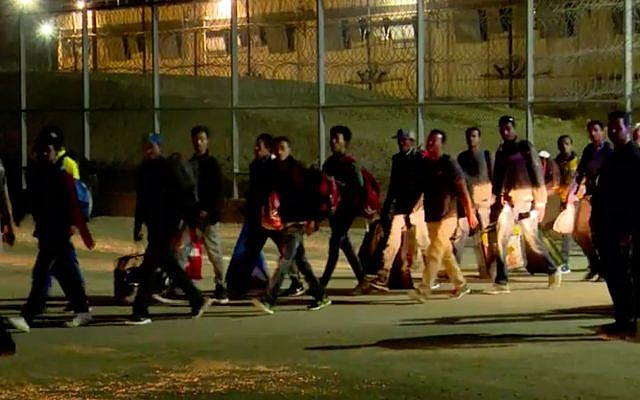 African asylum seekers exit the Saharonim Prison in southern Israel on April 4, 2018. (Screen capture/Hadashot news)