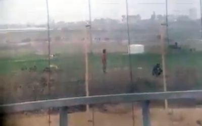 Footage filmed through a scope, publicized on April 9, 2018, that appears to show the moment before an Israeli sniper shoots a Palestinian who approached the Gaza security fence. (Screen capture)