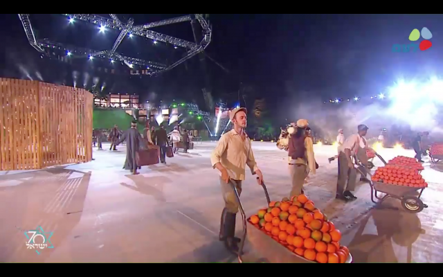 A scene depicting immigration and the pioneering early years of Israel, from Israel's opening 70th anniversary celebrations at Mount Herzl in Jerusalem, April 18, 2017 (GPO screenshot)