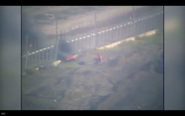 Still from footage released by the IDF on April 29, 2018 that shows Gazans attacking the border fence on April 27, 2018. (IDF screenshot)