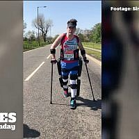 Britain's Simon Kindleysides, 34, paralyzed from the waist down, walked the London Marathon in 36 hours, with the help of the ReWalk exoskeleton, April 2018. (YouTube Screenshot)