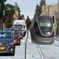 A glimpse at what Emek Refaim Street in the German Colony neighborhood of Jerusalem might look like with the light rail running through it. (Courtesy Refaim BaMoshavot)