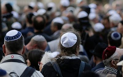 People wear kippas at a demonstration in Berlin, April 25, 2018. (AP/Markus Schreiber)