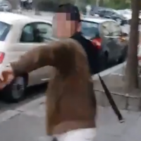 An Arabic-speaking man is seen preparing to whip a kippah-wearing non-Jewish man in an anti-Semitic attack in Berlin in a video published on April 18, 2018. (Screen capture: Twitter)
