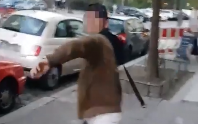 An Arabic-speaking man is seen preparing to whip a Jewish man in an anti-Semitic attack in Berlin in a video published on April 18, 2018. (Screen capture: Twitter)