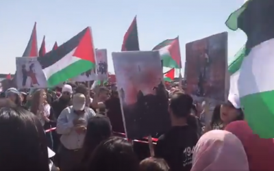 "Arab Israelis wave Palestinian flags and participate in a march commemorating the ""Nakba"" (catastrophe) that accompanied Israel's creation, in Atlit, northern Israel, on April 19, 2018, Israel's 70th Independence Day. (Screen capture: Twitter)"