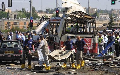 Paramedics and police at the scene of a Palestinian suicide-bombing that killed 19 and injuring 74 on a bus in Jerusalem, June 18, 2002. (Flash90/File)