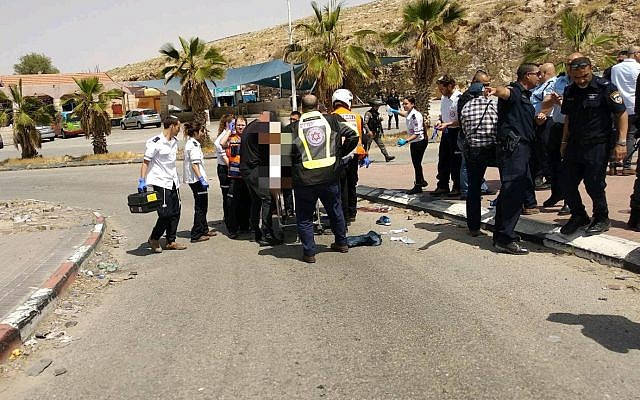 Israeli medics treat a man suspected of trying to stab someone at a West Bank gas station on April 8, 2018. (Magen David Adom)