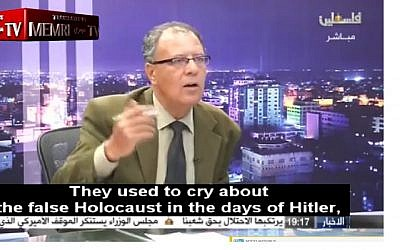 Screen capture from video of Palestinian political analyst and writer Hani Abu Zeid denying the Holocaust during an interview broadcast on Palestinian TV, April 10, 2018. (Facebook)