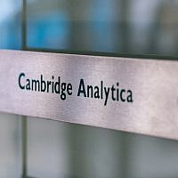 Signs for the company Cambridge Analytica in the lobby of the London, UK, building in which it is based, March 21, 2018. (Chris J Ratcliffe/Getty Images via JTA)