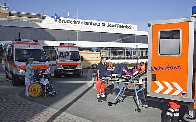 People being transported from the St. Josef hospital to other hospitals in Paderborn, Germany, as more than 26,000 people were asked to leave their homes in the western German town to allow specialists to remove a World War II-era bomb discovered during construction work. (Henning Kaiser/dpa via AP)