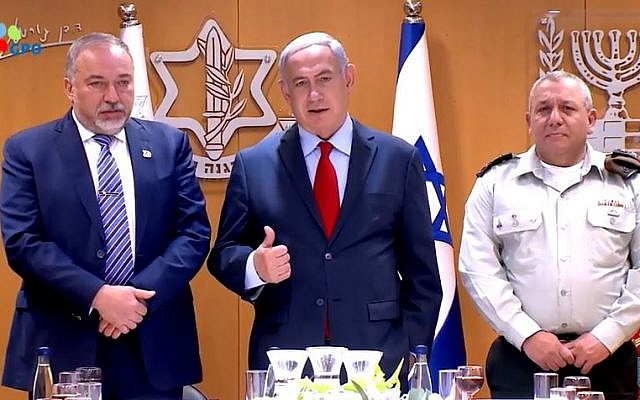 Prime Minister Benjamin Netanyahu (c) speaks at a toast in honor of Israel's 70th anniversary with Defense Minister Avigdor Liberman (L) and IDF Chief of Staff Gadi Eisenkot. (Screen capture/YouTube)