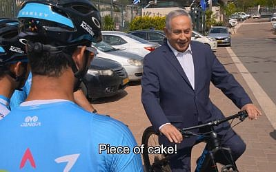 Prime Minister Benjamin Netanyahu hops on a bicycle in a video released on April 25, 2018, ahead of the Giro D'Italia cycle race to be held in Israel in May. (Screen capture: Twitter video)