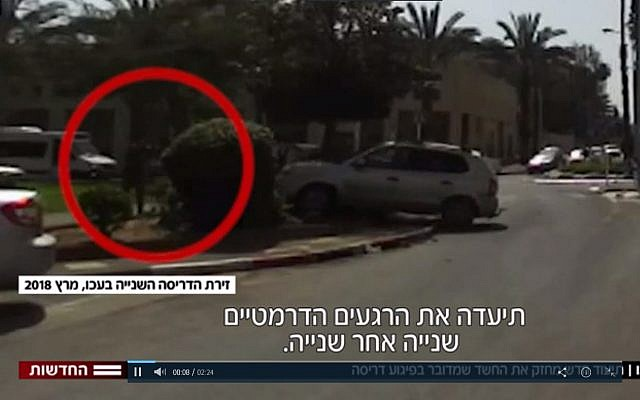 In this still from video, Malak Asadi can be seen driving his car towards a soldier in a car-ramming attack in Acre on March 4, 2018. (Screen capture: Hadashot news)