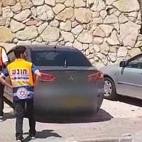 Two paramedics in the northern town of Rechasim where a baby boy died after being left in a car. (Screen capture: Ynet news)