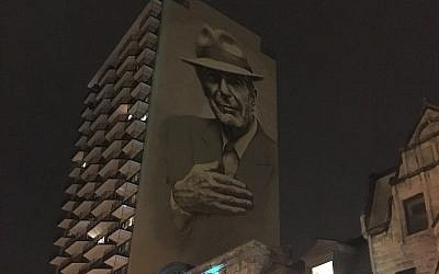 A painting of Leonard Cohen towers above Crescent Street in downtown Montreal. (Ben Harris/JTA)