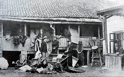 One of numerous photographs taken following the Kishinev pogrom of 1903. Here, a Jewish family stands outside of their ransacked home (public domain)