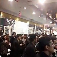 Thousands of people gather in a mall in Mashhad, Iran, to listen to a concert, leading some of them to dance on April 17, 2018. (Screen capture: Twitter video)