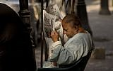 An Egyptian man reads a newspaper in the Zamalek district in Cairo, on October 27, 2016. (AP Photo/Amr Nabil)