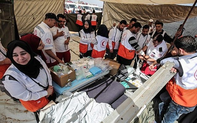 Palestinian paramedics set up near Khan Yunis, east of Gaza City, during protests on the Israel-Gaza border, April 6, 2018. (AFP PHOTO / SAID KHATIB)