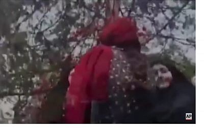 Screen capture from video of an encounter between an Iranian woman and the country's morality police, that allegedly in Tehran, Iran. (YouTube)