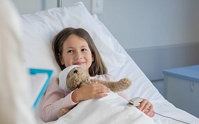 Illustrative. Girl in hospital bed. (iStock)