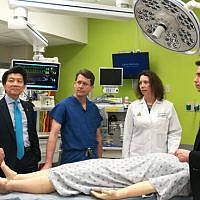 The team of surgeons at Johns Hopkins University gather round a mannequin. The university announced the first total penis and scrotum transplant on April 23, 2018. (Courtesy of Johns Hopkins)