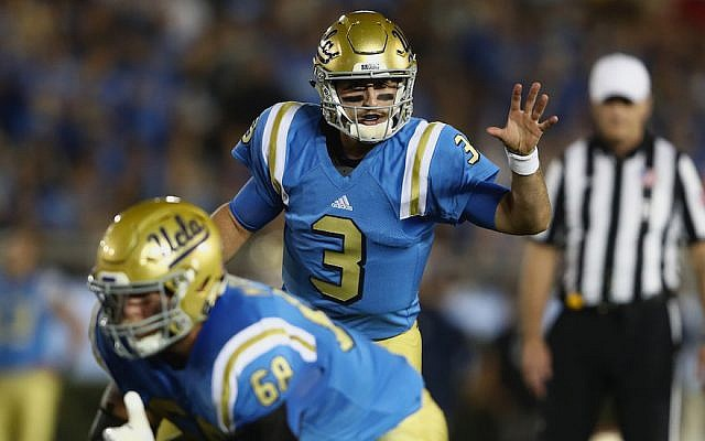 Josh Rosen #3 of the UCLA Bruins calls a play at the line of scrimmage during the first half of a game against the Arizona Wildcats  at the Rose Bowl in Pasadena, California, on October 1, 2016. (Sean M. Haffey/Getty Images via JTA)