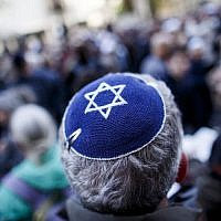 Illustrative: A participant wears a kippah during a 'wear a kippah' gathering to protest against anti-Semitism in front of the Jewish Community House on April 25, 2018 in Berlin, Germany. (Carsten Koall/Getty Images via JTA)