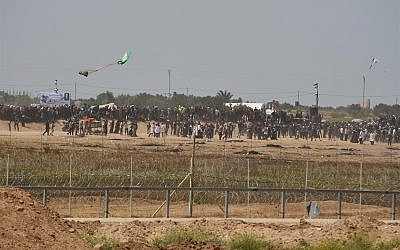 Illustrative: Palestinians try to use a kite to fly a Molotov Cocktail toward IDF troops along the Gaza fence on April 13 2018. (Israel Defense Forces)