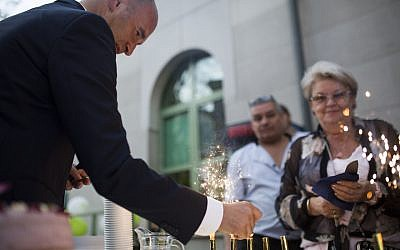 Jonathan Ornstein lighting fireworks at the 10th anniversary celebration of the Jewish Community Center in Krakow, April 22, 2018. (Jakub Włodek/via JTA)