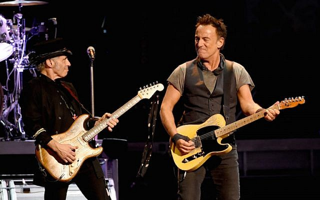 Musicians Nils Lofgren (L) and Bruce Springsteen and the E Street Band perform at the Los Angeles Sports Arena on March 15, 2016 in Los Angeles, California.  (Photo by Kevin Winter/Getty Images via JTA)
