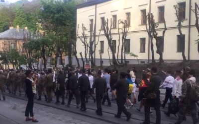 Far-right activists march in Lviv, Ukraine, wearing the uniform of the 14th Waffen Grenadier Division of the SS, an elite Nazi unite with many ethnic Ukrainians also known as the 1st Galician. April 28, 2018. (Screen capture; YouTube)