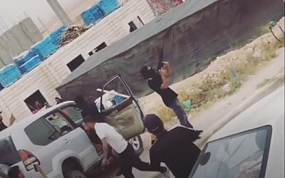 Bedouins seen shooting M-16s into the air on April 20, 2018, during a wedding procession near Ohalim Junction on Route 40. (Screencapture)