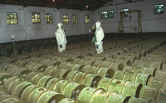In this May 20, 2000 file photo, two Russian soldiers make a routine check of metal containers with toxic agents at the Shikhany chemical weapons storage site in the town of Gorny, 124 miles (200 kms) south of the Volga River city of Saratov, Russia.  (AP Photo, File)