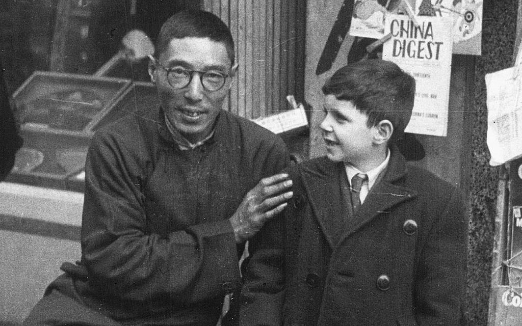 A Shanghai newspaper vendor with a young Jewish refugee during World War II. (Courtesy Above the Drowning Sea/ Time & Rhythm Cinema)