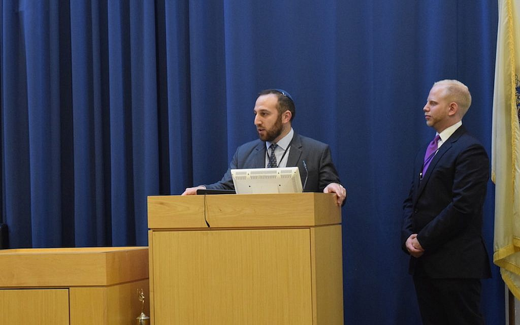 Rabbi Ira Dounn of the Princeton Center for Jewish Life addressing the Collegiate Moot Beit Din competition Sunday, April 15 as freshman Abraham Waserstein, who organized the event, looks on. (Courtesy of the Princeton Center for Jewish Life/via JTA)