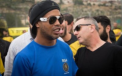 Ronaldinho, Brazilian former professional footballer, visits youngsters from Beitar Nordia Jerusalem at the Kraft Family Sports Campus in Jerusalem on April 26, 2018. (Yonatan Sindel/Flash90)