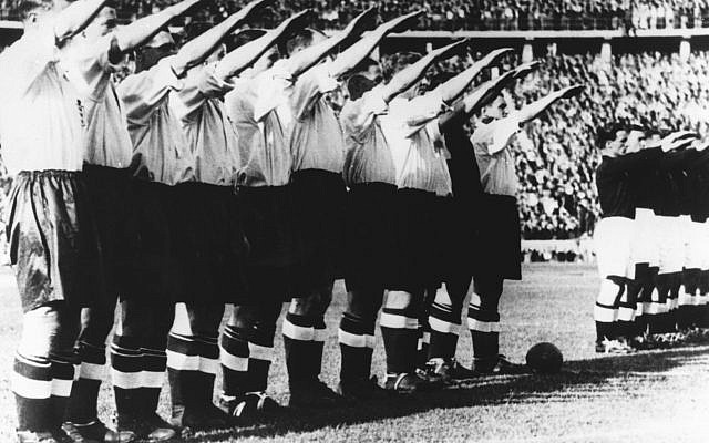 Before a record crowd of more than 100,000 people who filled Berlin's Olympic stadium. the English football team gave the Nazi salute in this May 14th, 1938, file photo. England beat Germany 6-3. (AP PHOTO).