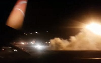 Smoke from an airport towing tug at the Ferenc Liszt International Airport on March 23, 2018, which panicked passenger on a flight taxiing for takeoff to Tel Aviv and prompted cabin crew to open the doors to deploy the emergency chutes. Dikla Abitbul, 38, fell from an open door onto the tarmac, sustaining serious injuries.