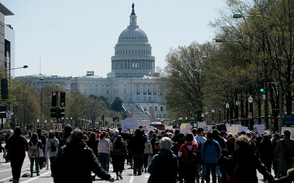 Participants in the National Walkout to protest gun violence marching toward the US Capitol, April 20, 2018. (Bonnie Jo Mount/The Washington Post via Getty Images/via JTA)