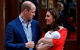 Britain's Prince William and Kate, Duchess of Cambridge pose for a photo with their newborn baby son as they leave the Lindo wing at St Mary's Hospital in London London, Monday, April 23, 2018. The Duchess of Cambridge gave birth Monday to a healthy baby boy — a third child for Kate and Prince William and fifth in line to the British throne. (AP Photo/Kirsty Wigglesworth)