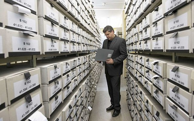 German prosecutor, head of Central Office of the Judicial Authorities of the Federal States for the Investigation of National Socialist Crimes, Jens Rommel stands in the archives room of the institution on April 19, 2018 in Ludwigsburg, southwestern Germany. (AFP PHOTO / THOMAS KIENZLE)